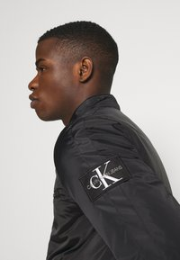 Calvin Klein Jeans - PADDED MOTO JACKET - Light jacket - black - 3