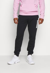 Calvin Klein Performance - PANTS - Teplákové kalhoty - black - 0