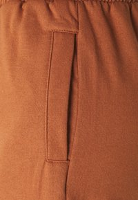 Trendyol - Tracksuit bottoms - camel - 2