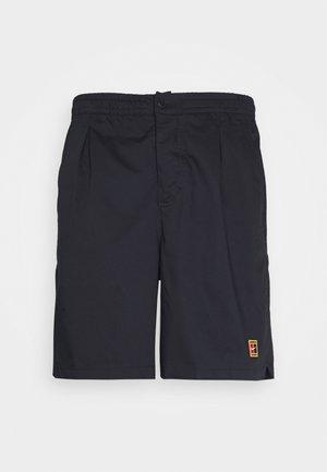 SHORT HERITAGE - Pantalón corto de deporte - black