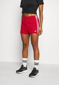adidas Performance - Krótkie spodenki sportowe - scarlet/white - 0