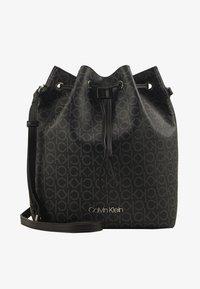 Calvin Klein - DRAWSTRING BUCKET BAG MONOGRAM - Sac bandoulière - black - 1