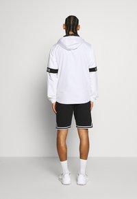 Lacoste Sport - TENNIS JACKET - Waterproof jacket - white/black - 2