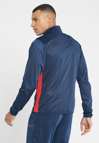 Uhlsport - ESSENTIAL CLASSIC - Tracksuit - blue/red - 2