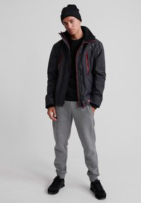 Superdry - HOODED POLAR WIND ATTACKER - Training jacket - charcoal - 1