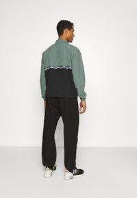 adidas Originals - SLICE - Training jacket - black/blue oxide - 2