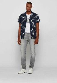 BOSS - Slim fit jeans - light grey - 1