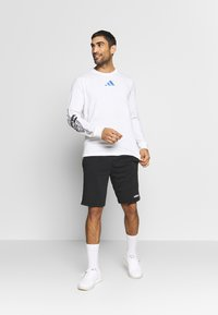 adidas Performance - SPACE RACE LONGSLEEVE - Pitkähihainen paita - white - 1