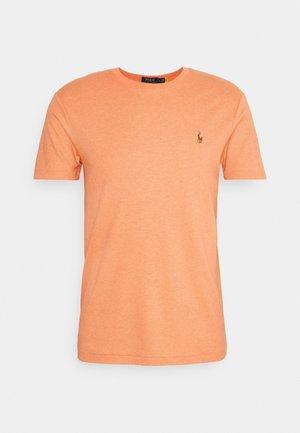 PIMA - Basic T-shirt - true orange heath