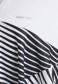 Lotto - TOP TEN DRESS - Sports dress - bright white/black - 0