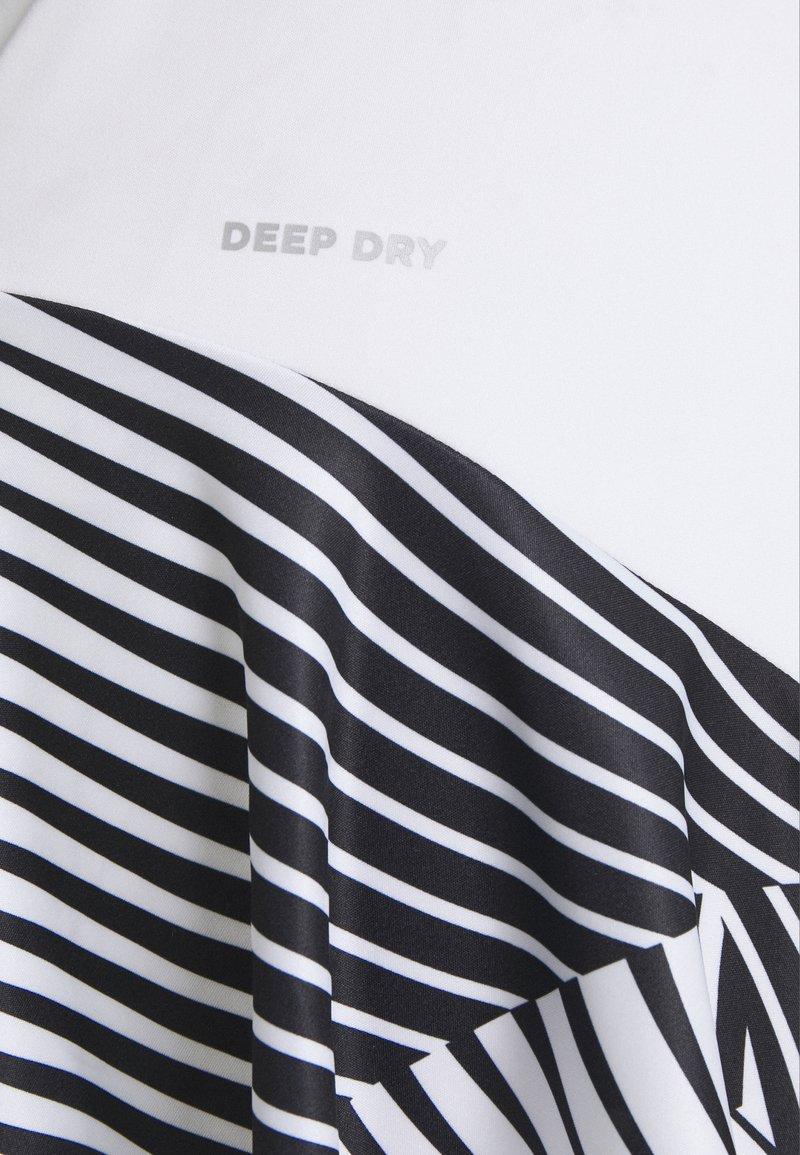 Lotto - TOP TEN DRESS - Sports dress - bright white/black