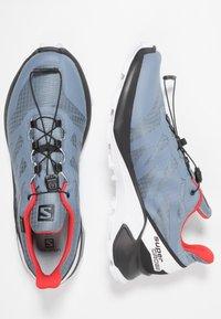 Salomon - SUPERCROSS GTX - Trail running shoes - flint stone/black/high risk red - 1