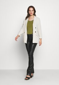 Ibana - LUCILLE - Leather trousers - black - 1
