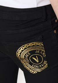 Versace Jeans Couture - RINSE - Jean slim - black - 9