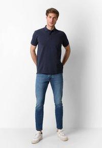 Scalpers - Polo shirt - navy - 1