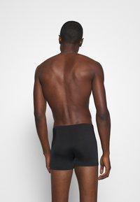 Puma - CLASSIC SWIM TRUNK - Costume da bagno - black - 1