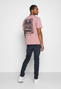 Diesel - D-LUSTER - Slim fit jeans - 009em - 2