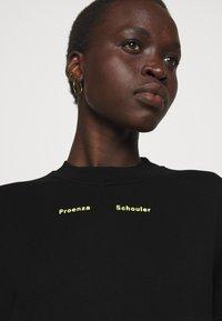 Proenza Schouler White Label - MODIFIED RAGLAN SOLID - Sweatshirt - black - 4