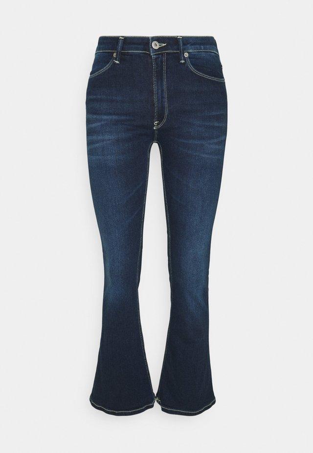 MANDY - Jeans a zampa - yellow/blue denim