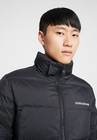 Calvin Klein Jeans - HOODED DOWN PUFFER  - Winter jacket - black - 10
