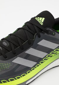 adidas Performance - SOLAR GLIDE BOOST RUNNING SHOES - Zapatillas de running neutras - grey five/silver metallic/signal green - 5