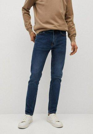 JUDE - Slim fit jeans - bleu foncé