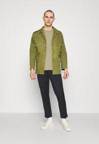 Filippa K - ROLL NECK TEE - Basic T-shirt - sage green - 1