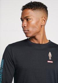 Levi's® - LEVI'S® X STAR WARS GRAPHIC TEE - Langarmshirt - black - 3