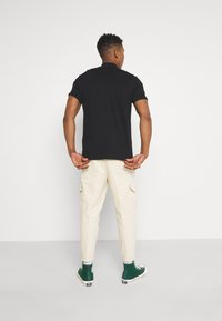 Redefined Rebel - JACOB PANTS - Cargo trousers - sandshell - 2