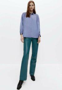 Uterqüe - Leather trousers - green - 1
