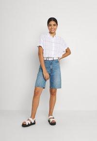 Weekday - URI SHIRT - Button-down blouse - whith/purple - 1