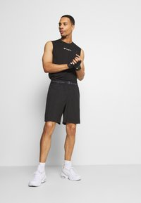 Champion - LEGACY TRAINING BERMUDA - Urheilushortsit - black - 1
