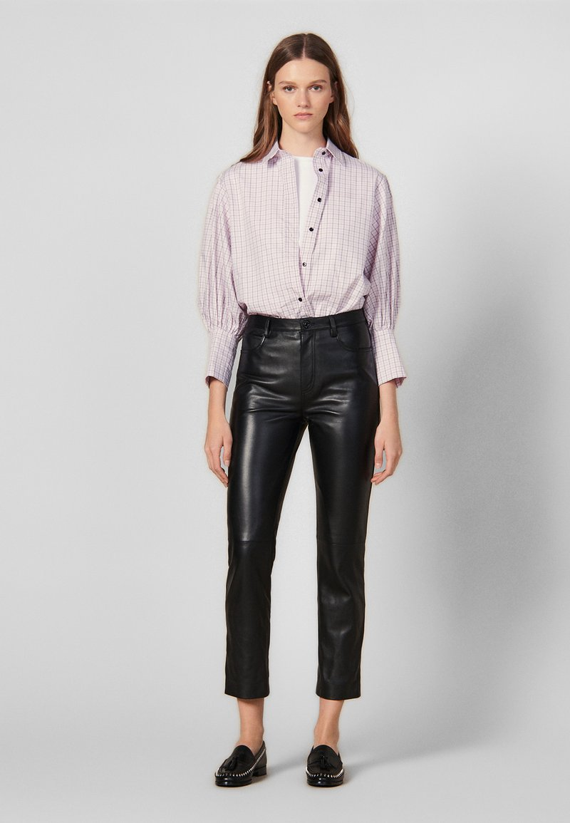 sandro - LEATH - Leather trousers - black