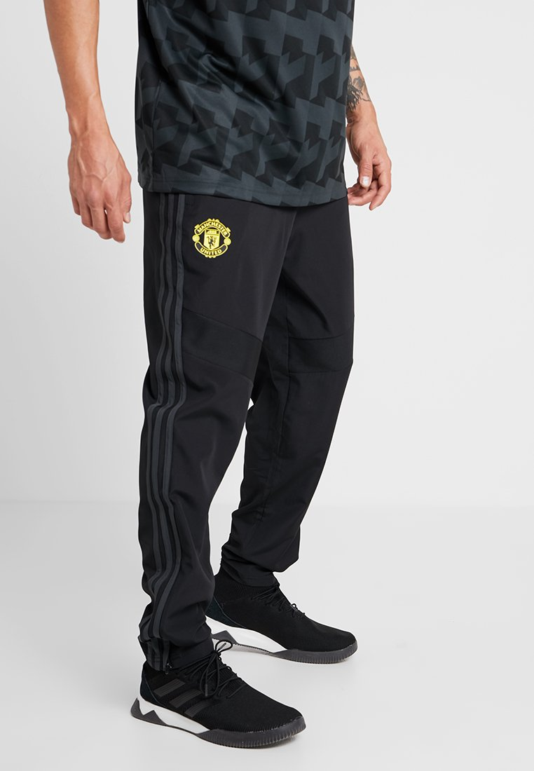 adidas Performance - MANCHESTER UNITED FC - Tracksuit bottoms - black/green