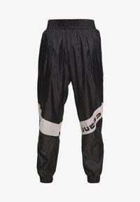 PANT - Tracksuit bottoms - jet black