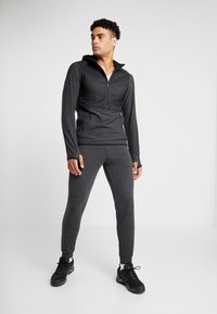 Icebreaker - MENS SHIFTER PANTS - Tracksuit bottoms - mottled black - 1