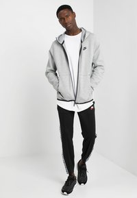 Nike Sportswear - TECH FULLZIP HOODIE - Mikina na zip - dark grey heather/black - 1