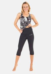 Winshape - HWL202 SCHWARZ HIGH WAIST- 3/4 SPORTHOSE - 3/4 sports trousers - schwarz - 1