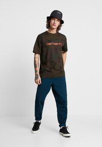 Carhartt WIP - SINGLE KNEE PANT DEARBORN - Jeans Straight Leg - duck blue rinsed - 1