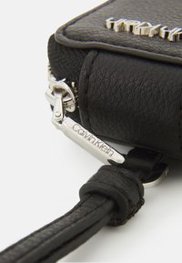 Calvin Klein - IPOD AIR DANGLE - Other accessories - black - 4