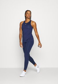 Nike Performance - TANK ALL OVER  - T-shirt de sport - binary blue/white - 1