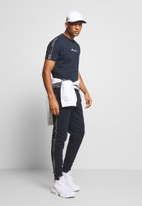 Champion - LEGACY  - Tracksuit bottoms - dark blue - 1