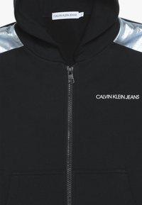 Calvin Klein Jeans - FOIL BLOCK RAGLAN ZIP HOODIE - Mikina na zip - black - 4