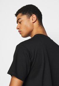 GCDS - CROP TEE - T-shirt basique - black - 5