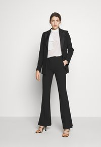 Victoria Victoria Beckham - SPLIT HEM TUXEDO TROUSER - Spodnie materiałowe - black - 1