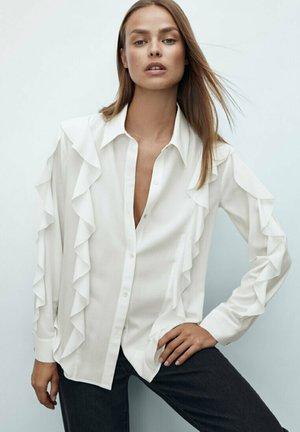 MIT VOLANTÄRMELN - Button-down blouse - beige