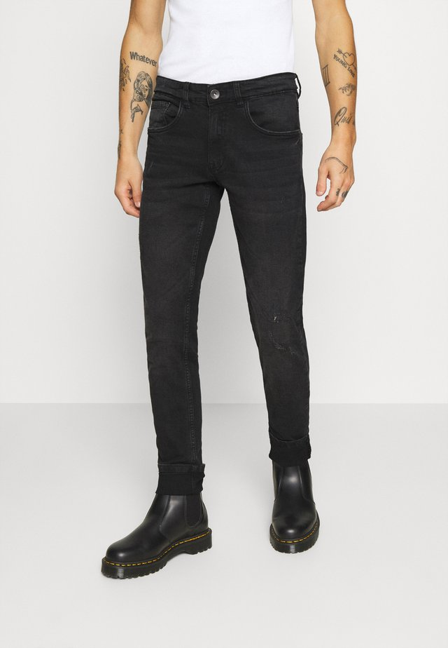 STOCKHOLM DESTROY - Jeans slim fit - edgy black