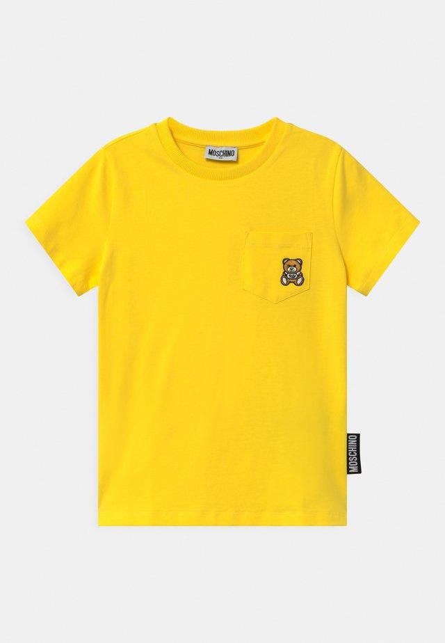 UNISEX - T-shirt print - cyber yellow