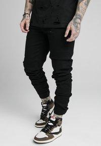 SIKSILK - ELASTICATED STRAP CUFF - Jeans slim fit - black - 0