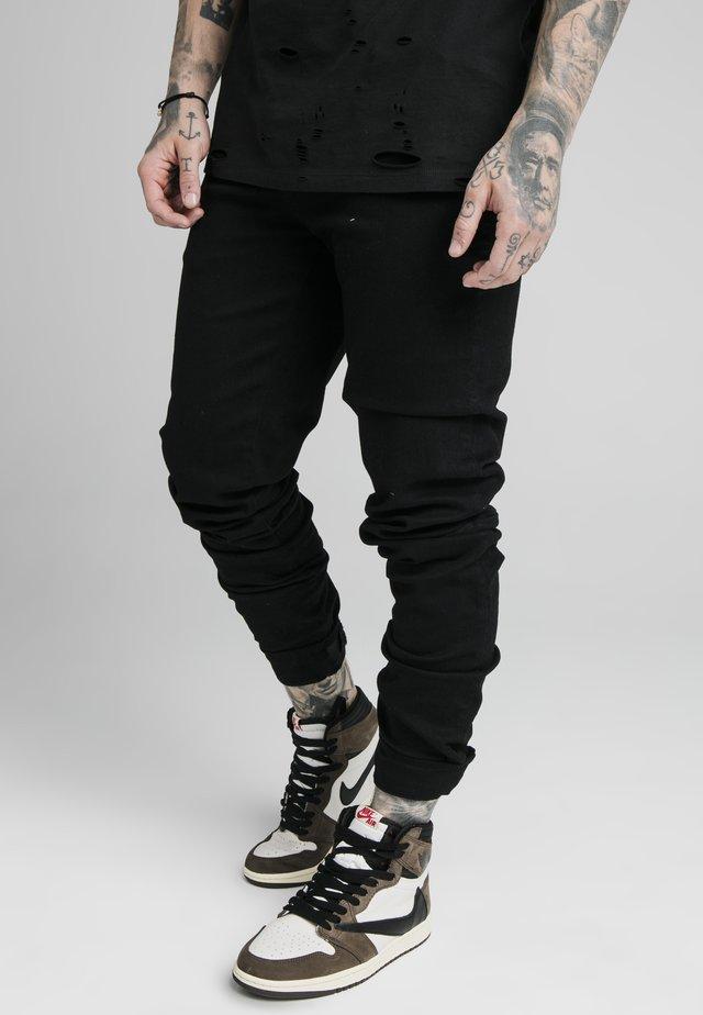 ELASTICATED STRAP CUFF - Slim fit jeans - black